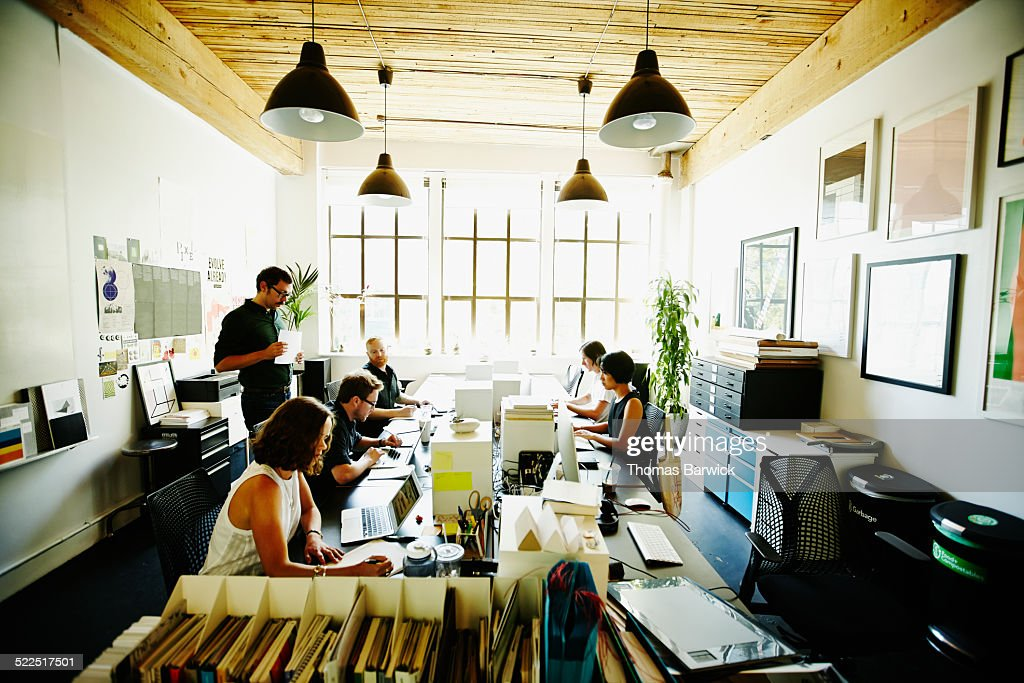 Businessmen and businesswomen in startup office : Stock Photo