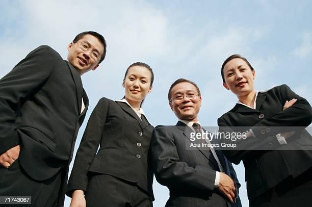 businessmen and businesswomen looking down at camera - down blouse stock-fotos und bilder