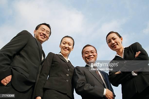 businessmen and businesswomen looking down at camera, smiling - down blouse stock-fotos und bilder