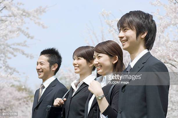 Businessmen and businesswomen smiling