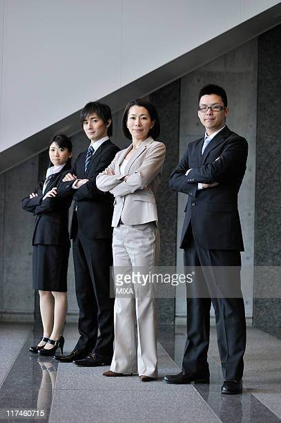 Businessmen and businesswomen standing at lobby of building
