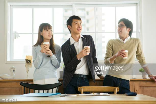 Businessmen and woman having coffee break