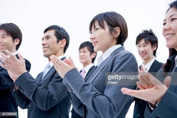 businessmen and women clapping - 拍手喝采 ストックフォトと画像