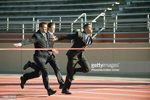 Businessmen approaching finish line in race
