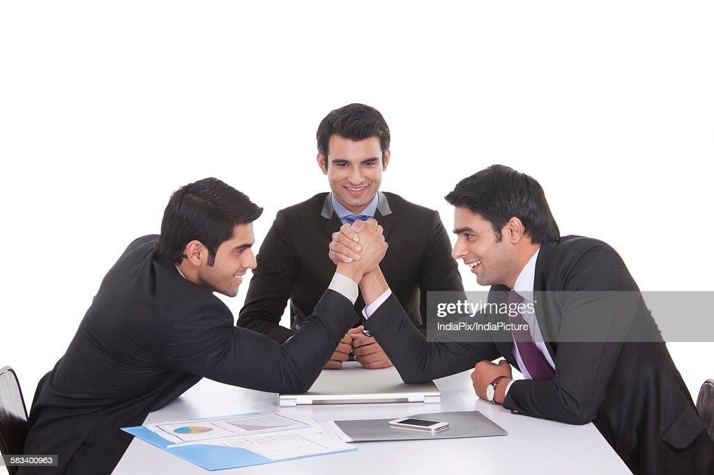Businessmen arm wrestling : Stock Photo