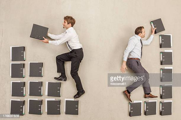 Businessmen arranging files in office