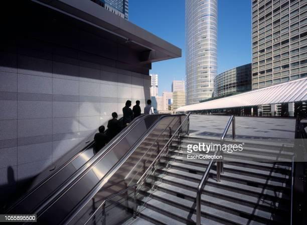 Businessmen arriving at modern business district