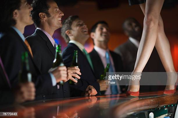 Businessmen at a Strip Club
