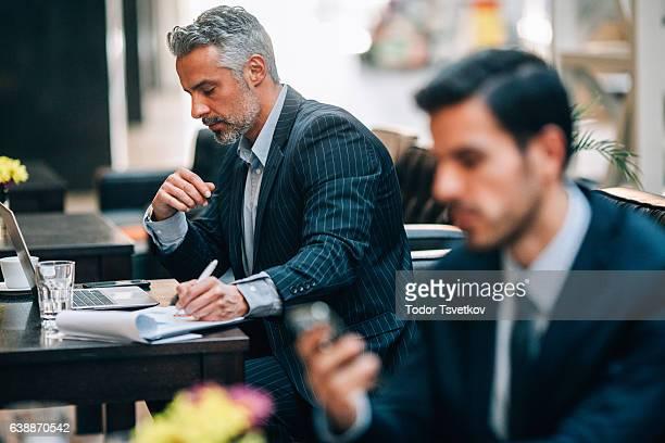 Businessmen at an internet cafe