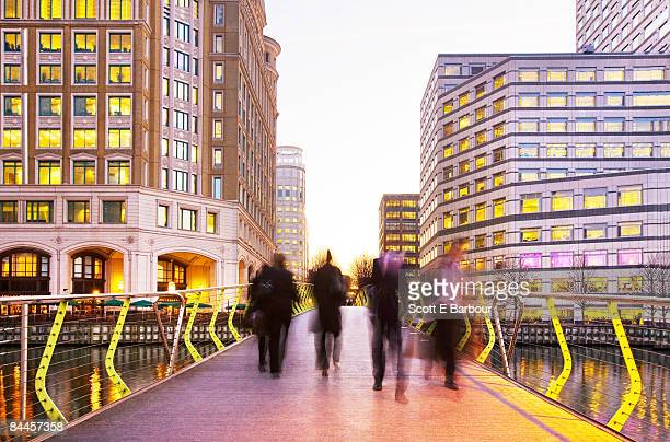 businessmen at canary wharf - canary wharf stock pictures, royalty-free photos & images