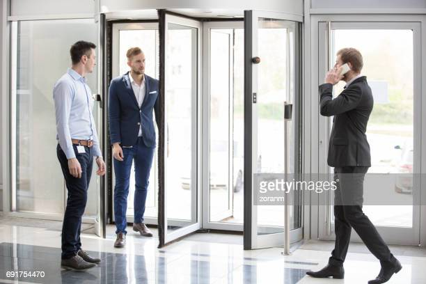 Businessmen at entrance of an office building