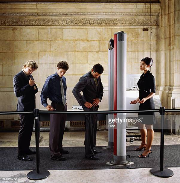 businessmen at security checkpoint - security scanner stock pictures, royalty-free photos & images