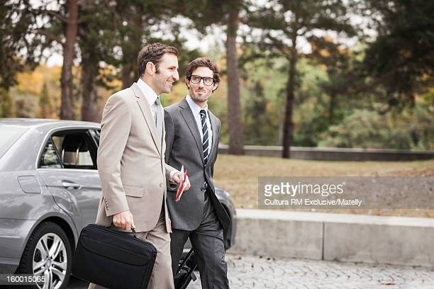 Businessmen carrying luggage