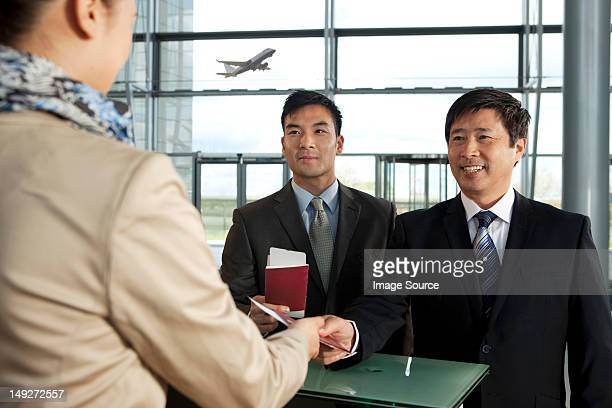 Businessmen checking in at airport
