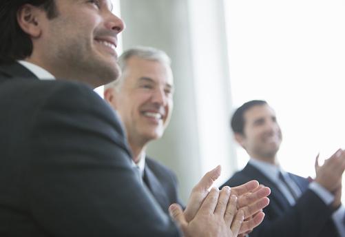 Businessmen clapping in meeting - gettyimageskorea