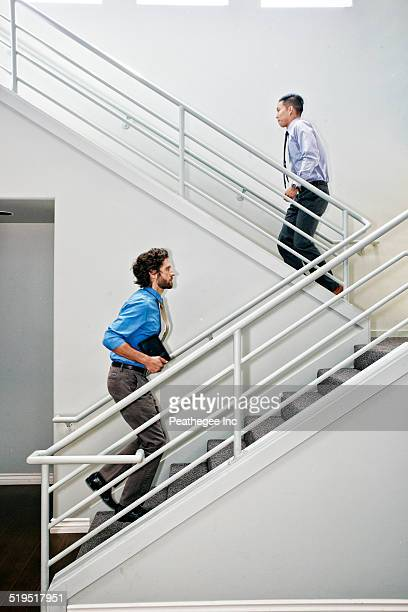 Businessmen climbing staircase