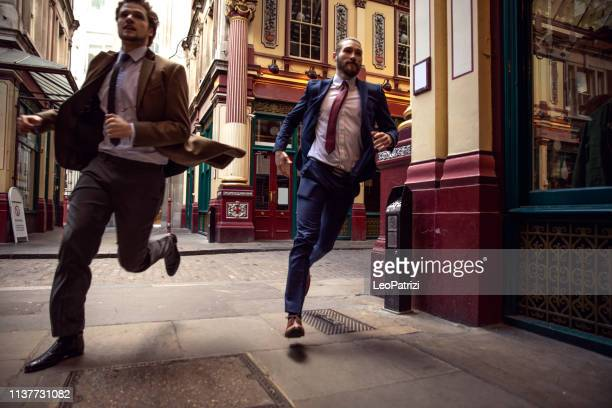 businessmen colleagues on the go in the city - central london - speed stock pictures, royalty-free photos & images