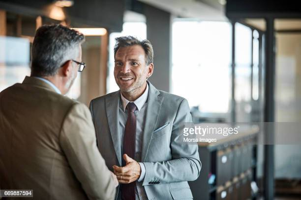businessmen communicating in textile factory - concepts & topics stock pictures, royalty-free photos & images
