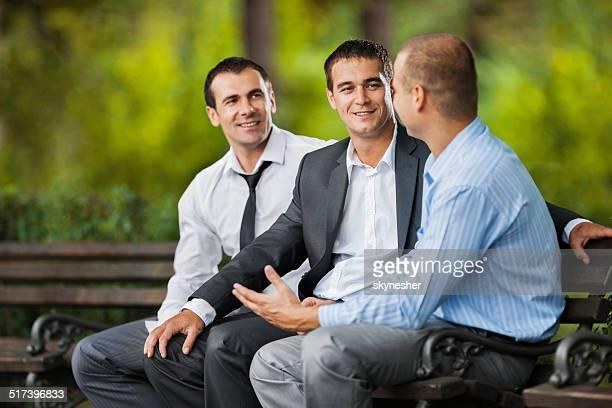 Businessmen communicating outdoors.