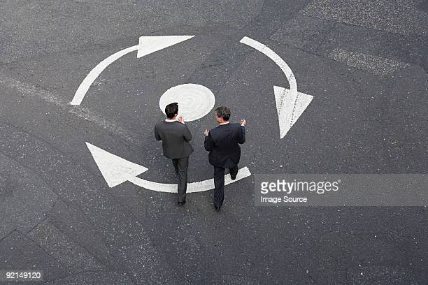 Businessmen crossing the road