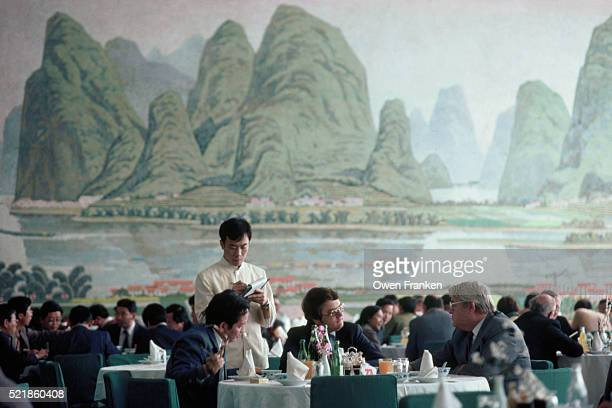 Businessmen Discuss Foreign Investment Over Lunch