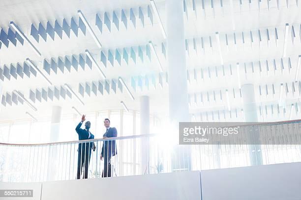 Businessmen discussing ideas in modern office