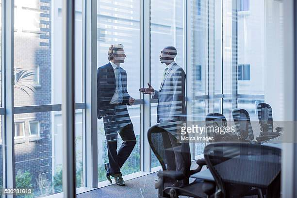 Businessmen discussing in board room