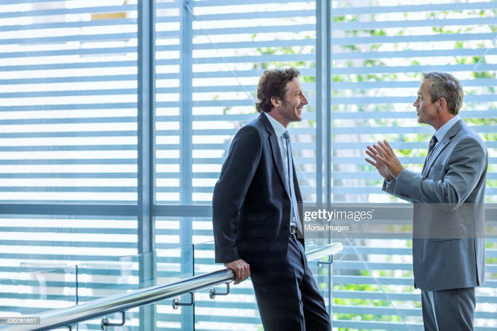 Businessmen discussing in office : Stock Photo