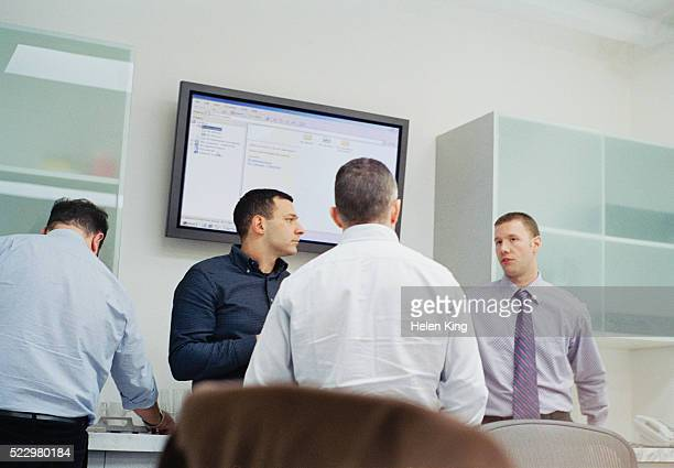 Businessmen Discussing Plans at Meeting