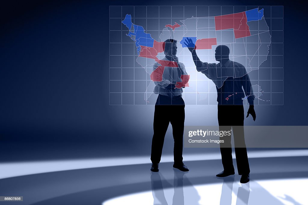 Businessmen discussing political map : Stock Photo