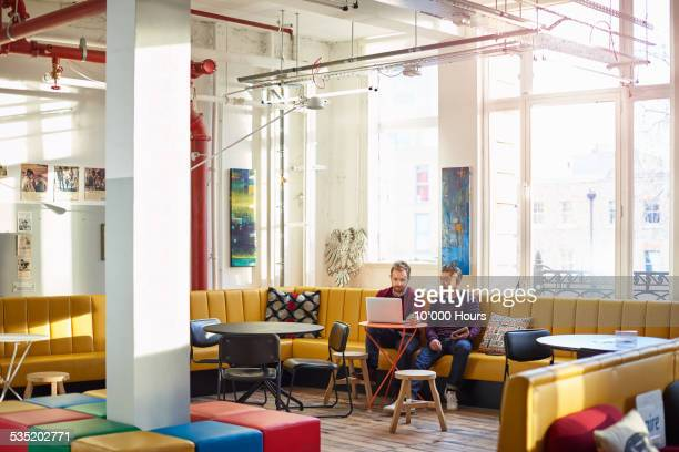 businessmen discussing project in creative office - creative occupation stock pictures, royalty-free photos & images