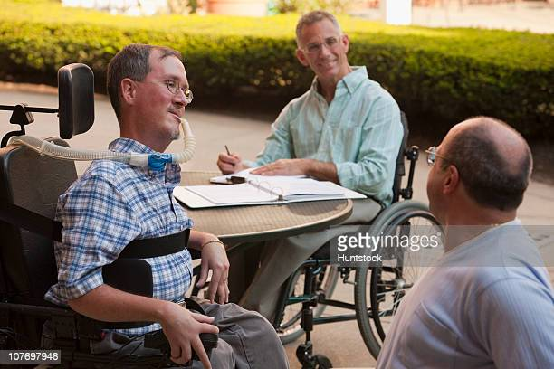 businessmen doing paperwork - duchenne muscular dystrophy stock photos and pictures