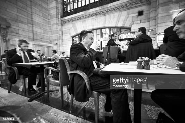 businessmen drink coffee in a cafe at the grand central station in manhattan, new york city - coffee drink stock pictures, royalty-free photos & images