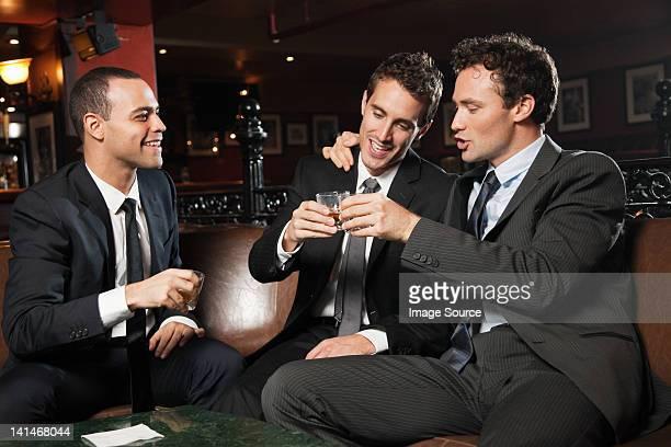 Businessmen drinking together in bar
