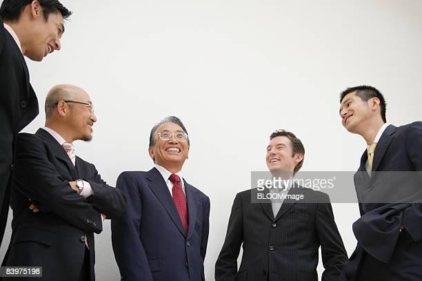 Businessmen enjoying chatting, smiling