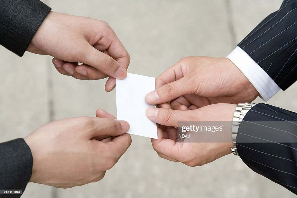Businessmen exchanging business cards china beijing stock photo businessmen exchanging business cards china beijing reheart Choice Image