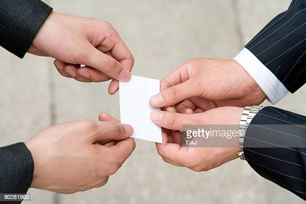 Businessmen Exchanging Business Cards, China, Beijing