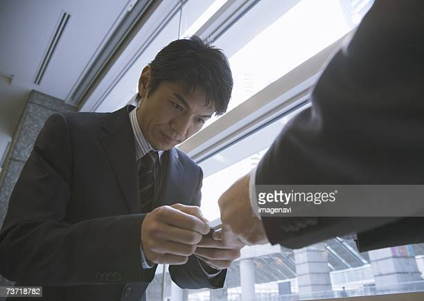 Businessmen exchanging business cards