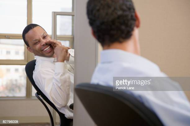 businessmen exchanging gossip - gossip stock pictures, royalty-free photos & images
