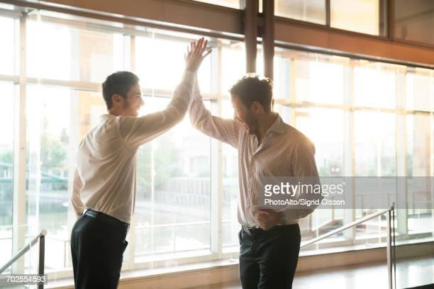 Businessmen exchanging high-five