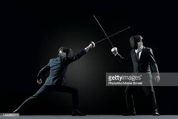 businessmen fencing - face off sports play stock photos and pictures