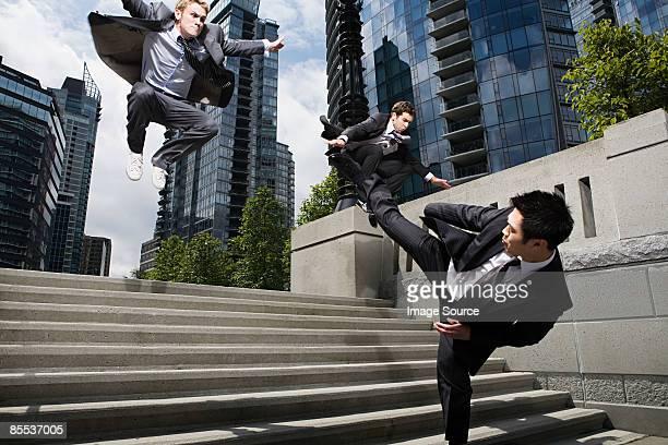 Businessmen fighting
