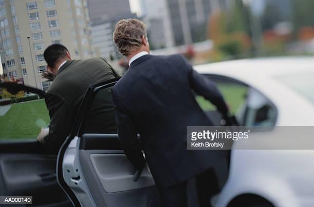 Businessmen Getting Into a Car