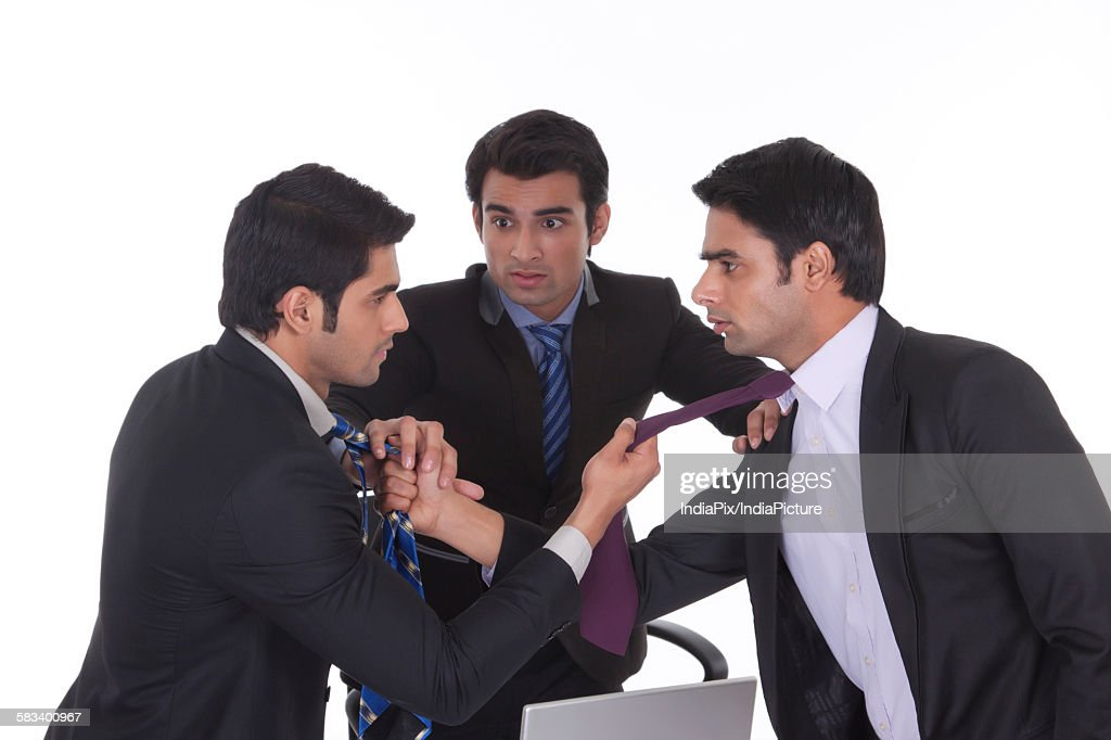 Businessmen getting into a fight : Stock Photo