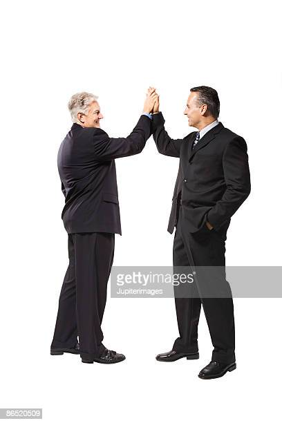 Businessmen giving each other high five