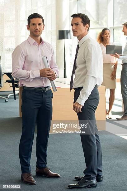 Businessmen gossipping