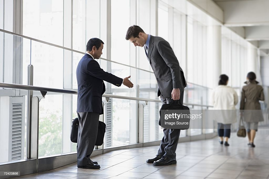 Businessmen greeting : Stock Photo