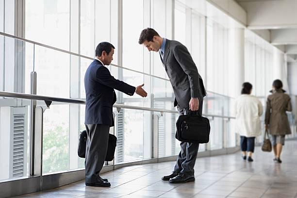 Businessmen greeting