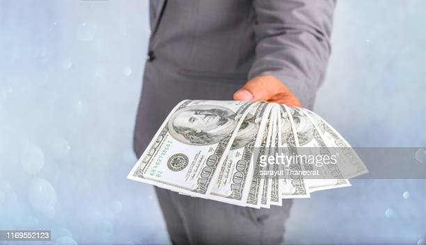 businessmen hand to send money, bank notes, catch money, payment concepts - borrowing stock pictures, royalty-free photos & images