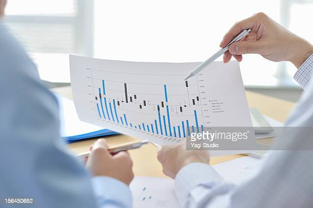 businessmen  having discussion in office - printed media stock pictures, royalty-free photos & images